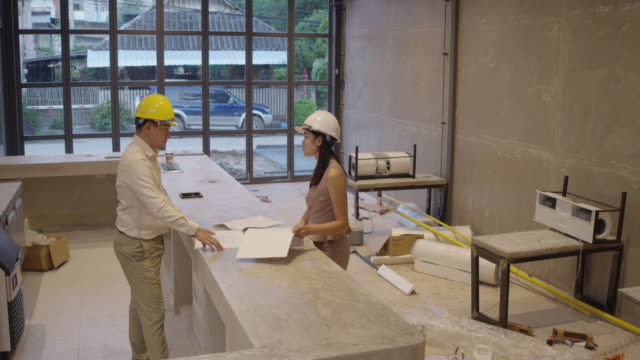 discuss work in construction site the professional engineer checking work. - quality control stock videos & royalty-free footage