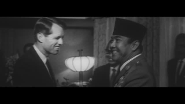 discussing the malaysia question in tokyo / prime minister ikeda and indonesian president sukarno shake hands over malaysian dispute attorney general... - robert kennedy attorney general stock videos & royalty-free footage