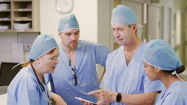 discussing the way forward for their patients - surgeon stock videos & royalty-free footage