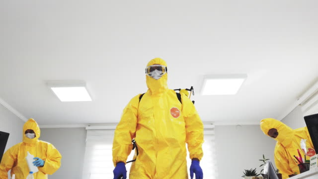 disease control service staff disinfecting office - yellow stock videos & royalty-free footage
