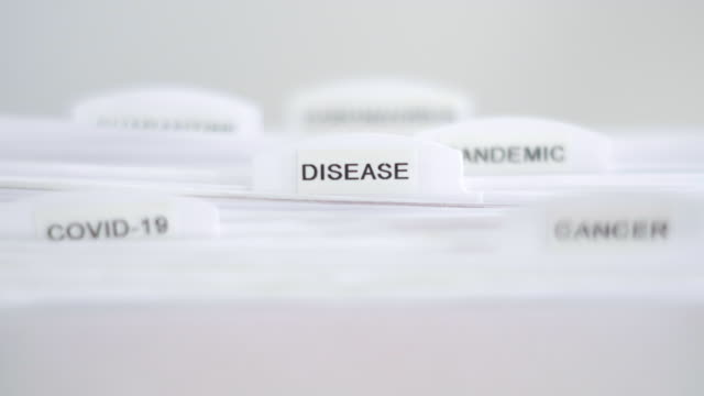 disease file folder label - filing documents stock videos & royalty-free footage