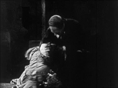 b/w 1925 disfigured man (lon chaney, sr.) grabbing woman (mary philbin) by hair / feature - 1925 stock videos & royalty-free footage
