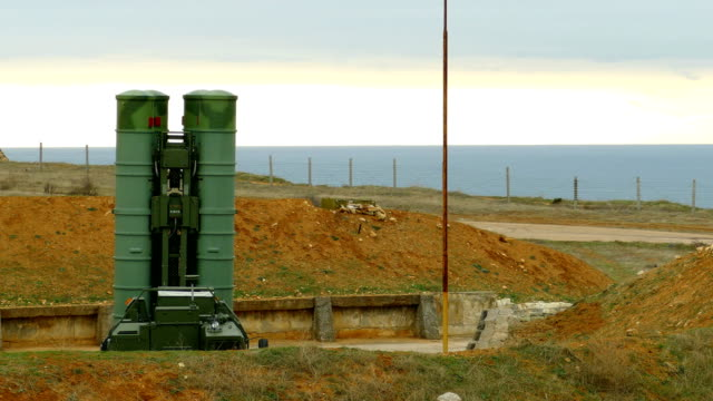 disguised anti-aircraft missile system on the coast in combat position - rocket launcher stock videos & royalty-free footage