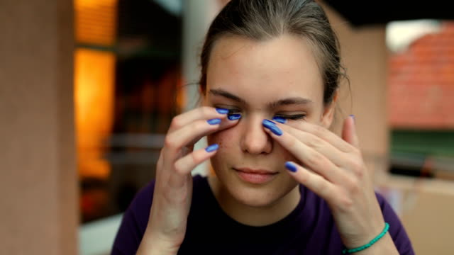 disgusted young woman rubbing her eyes - complaining stock videos & royalty-free footage