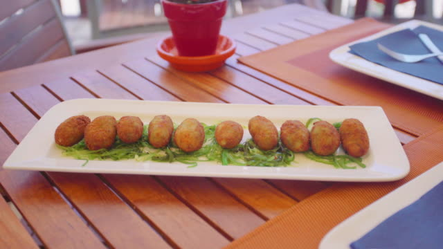 dish of croquettes in a restauran table - croquette stock videos and b-roll footage