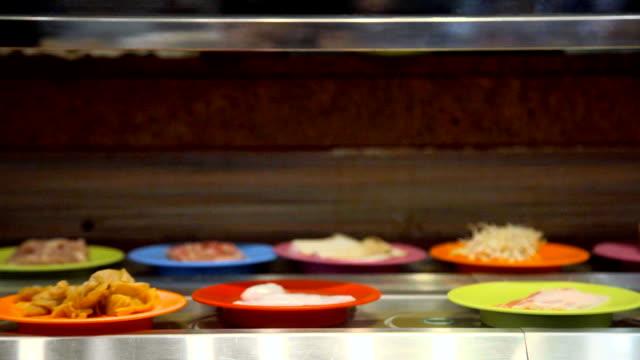 dish of raw food shabu conveyor belt for barbecue grill - mollusk stock videos & royalty-free footage
