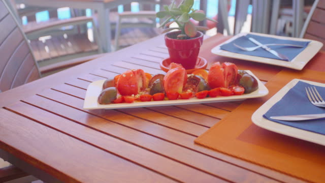 dish of tomato salad in a restauran table - tomato salad stock videos & royalty-free footage