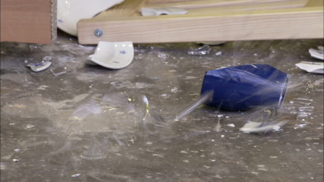 dishes smash on the floor during an earthquake simulation. available in hd. - earthquake stock videos and b-roll footage