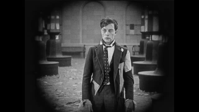 1920 disheveled exhausted stock trader (buster keaton) upset when he sees the news about company - stock market crash stock videos & royalty-free footage