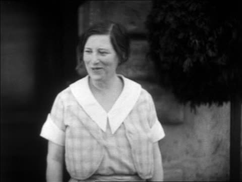 B/W 1931 dishevelled woman smiling outdoors / feature