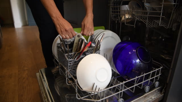 dishwasher being emptied in a domestic kitchen - full stock videos & royalty-free footage