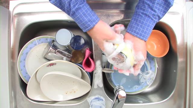 hd time-lapse: dish-washing - scrubs stock videos & royalty-free footage