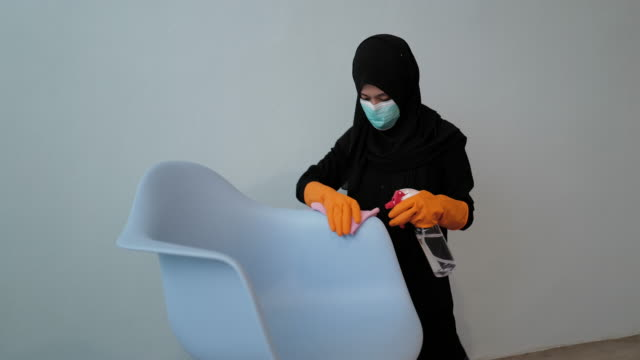 disinfecting blue chair - modest clothing stock videos & royalty-free footage