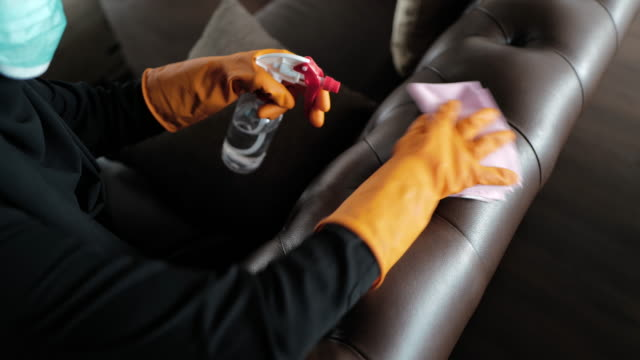 disinfecting brown leather sofa - washing up glove stock videos & royalty-free footage