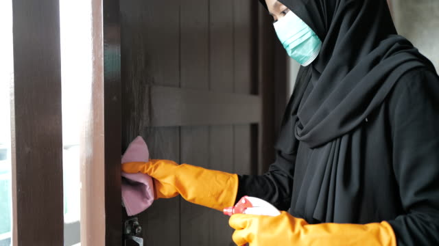 disinfecting door knob - modest clothing stock videos & royalty-free footage