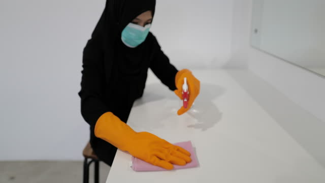 disinfecting white table top - モデスト・ファッション点の映像素材/bロール