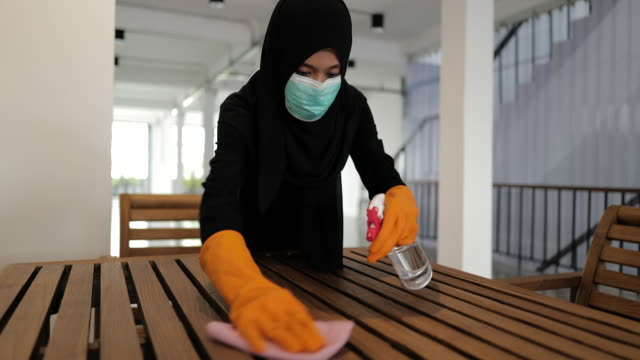 disinfecting wooden furniture set - modest clothing stock videos & royalty-free footage