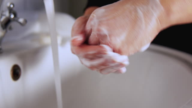 disinfection of hands. - soap sud stock videos & royalty-free footage