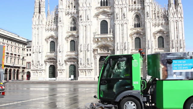 disinfection trucks clean down piazza del duomo during the covid19 pandemic in milan italy - healthcare and medicine or illness or food and drink or fitness or exercise or wellbeing video stock e b–roll