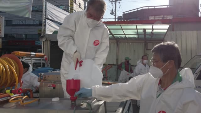 disinfection workers wearing personal protective equipment , get ready to disinfect a street to prevent the coronavirus spread on october 06, 2020 in... - korean new year stock-videos und b-roll-filmmaterial