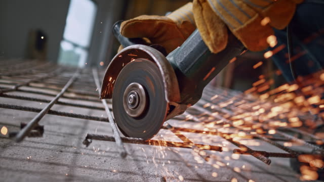 slo mo disk of the angle grinder causing sparks to fly into the air - steel stock videos & royalty-free footage