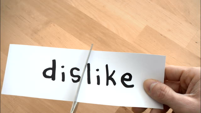 dislike to like by scissors - cutting stock videos and b-roll footage