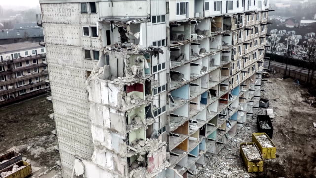 dismantling of a building aerial shot - demolishing stock videos & royalty-free footage