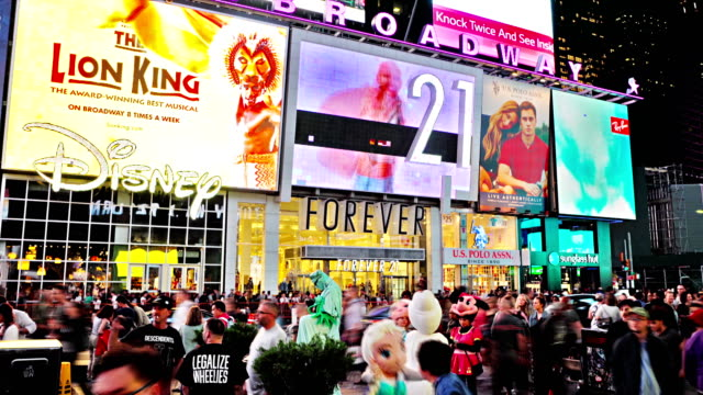 disney. forever 21. time square - disney stock videos and b-roll footage