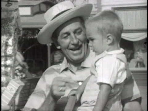 disney holds his grandson takes him on rides - disney stock videos and b-roll footage