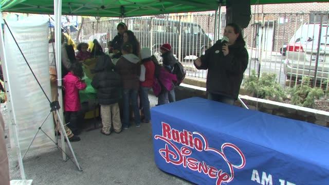 disney radio mc at the wilmer valderrama helps nyc kids plant community garden at new york ny - wilmer valderrama stock videos and b-roll footage
