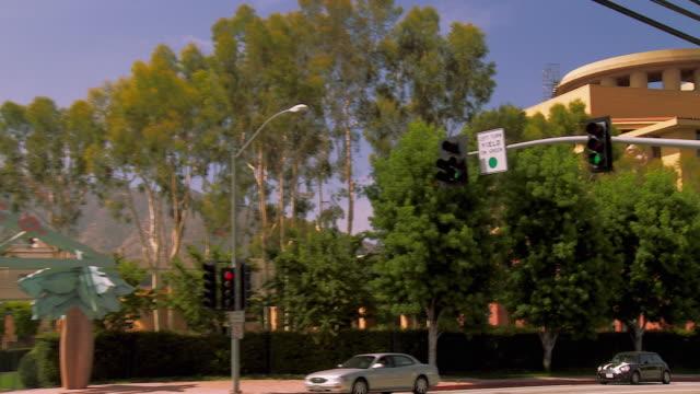 ws zo pan disney studio main building to studio gate entrance / burbank, california, usa   - disney stock videos & royalty-free footage