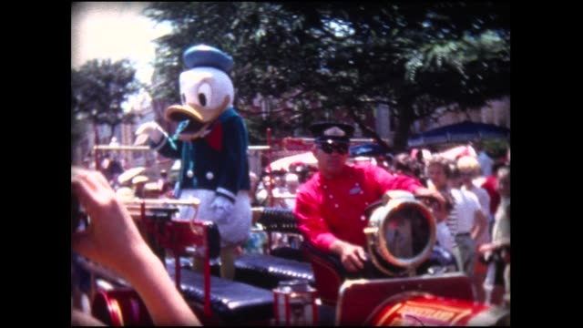 1969 disneyland. parade with donald duck - disney stock videos and b-roll footage