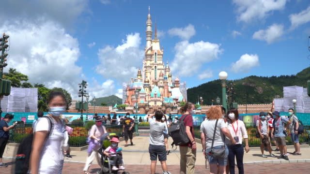disneyland reopened thursday under health restrictions to check the spread of infections in a pandemic that's seeing a second wave of outbreaks,... - schlossgebäude stock-videos und b-roll-filmmaterial