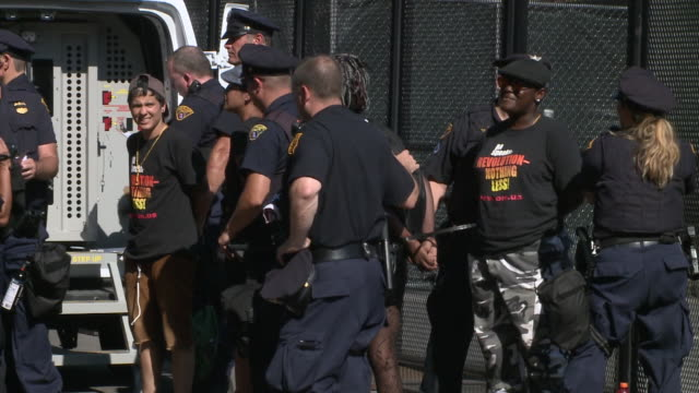 disorderly protesters arrested outside the rnc. protestors continue to chant after being placed in custody. republican national convention 2016 at... - terrorism stock videos & royalty-free footage