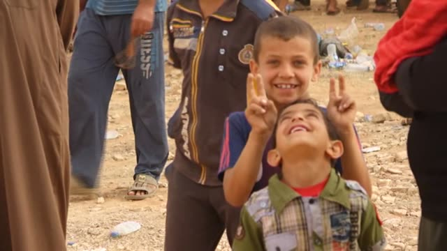 Displaced Iraqis who fled the towns of Hit and Kubaysa after Iraqi forces launched a broad offensive to retake the cities from the Islamic State IS...