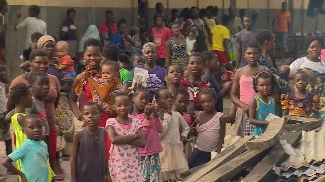 displaced people from cyclone idai being sheltered in school in berai mozambique - emergency shelter stock videos & royalty-free footage