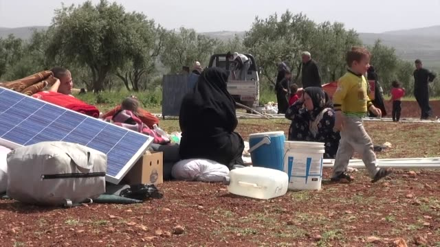 displaced syrians camping in fields after having fled idlib after attacks by government forces trying to take over areas still held by rebel islamist... - refugee stock videos & royalty-free footage