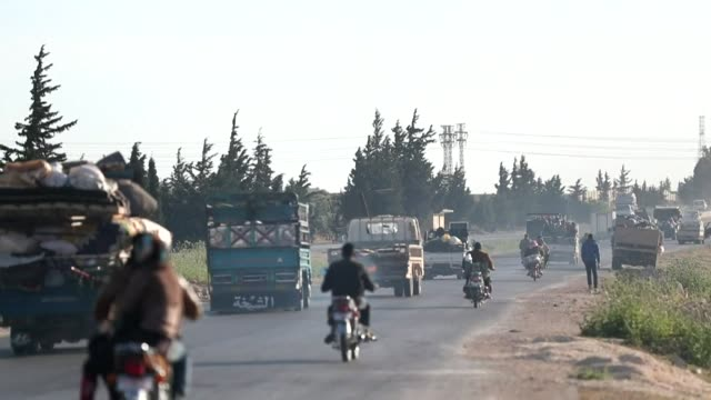 Displaced Syrians fleeing Idlib after attacks by Government forces trying to take over areas still held by rebel Islamist fighters