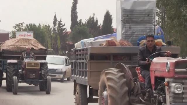 displaced syrians were seen tuesday in the countryside of afrin fleeing the turkey led assault on the rebel enclave controlled by the kurdish... - people's protection units stock videos & royalty-free footage