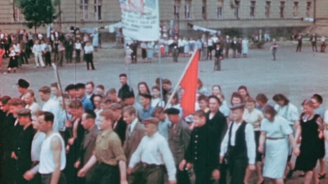 ha displaced workers celebrating ve day with soviet flags and marching in parade / germany - former ussr flag stock videos & royalty-free footage