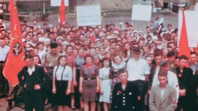 displaced workers celebrating ve day with soviet flags and portrait of stalin / germany - parade stock videos & royalty-free footage