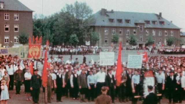displaced workers celebrating ve day with soviet flags, marching parades, and portrait of stalin / germany - russian flag stock videos & royalty-free footage