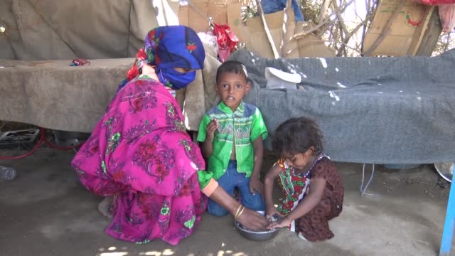 displaced yemenis take shelter at the alwaara camp in the khokha district as millions are caught up in a dragging war in which huthi rebels have been... - yemen stock videos and b-roll footage