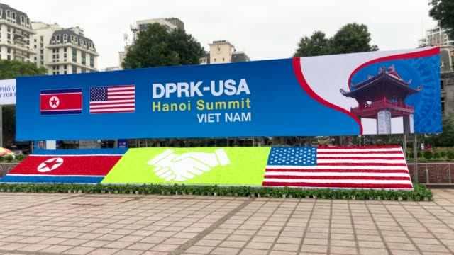 a display board announcing the forthcoming dprkusa summit at the international media centre on february 24 2019 in hanoi vietnam preparations... - 首脳会議点の映像素材/bロール