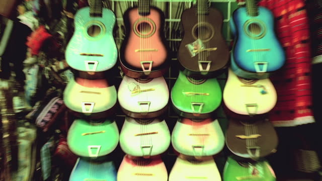 zi display of acoustic guitars at olvera street marketplace, showing unnatural colors / los angeles, california, united states - collection stock videos and b-roll footage