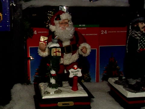A display of Christmas decorations featuring Father Christmas