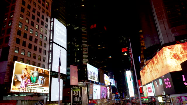 display of electronic billboard advertisements in manhattan's times square at night broadway and 7th avenue new york city - broadway manhattan video stock e b–roll