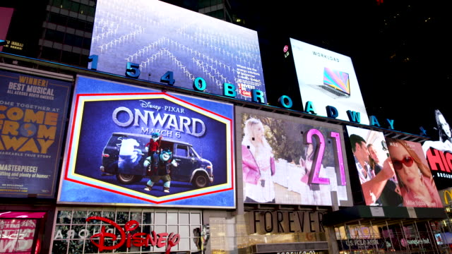 display of electronic billboard advertisements in times square at night broadway and 7th avenue. - electronic billboard stock videos & royalty-free footage