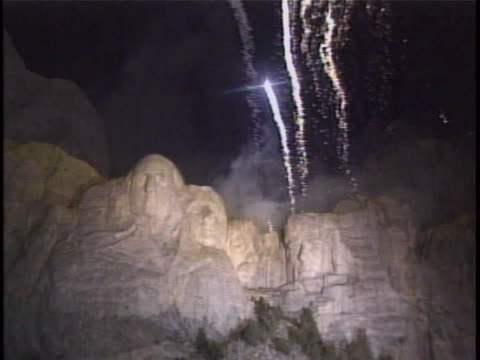 stockvideo's en b-roll-footage met display of fireworks is seen over mt rushmore on 4th of july. mount rushmore national memorial is a sculpture carved into the granite face of mount... - zuid dakota