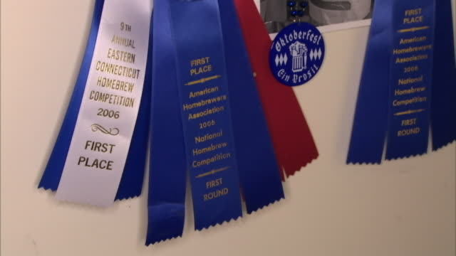 a display of first-place ribbons shows expertise in home-brewing competitions. - award ribbon stock videos & royalty-free footage